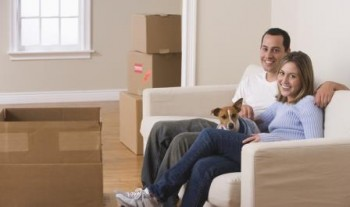 Couple and dog in new home