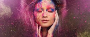 lady covered in paint depicting aura colours